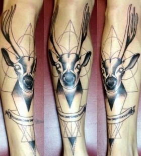 Geometric deer leg tattoo