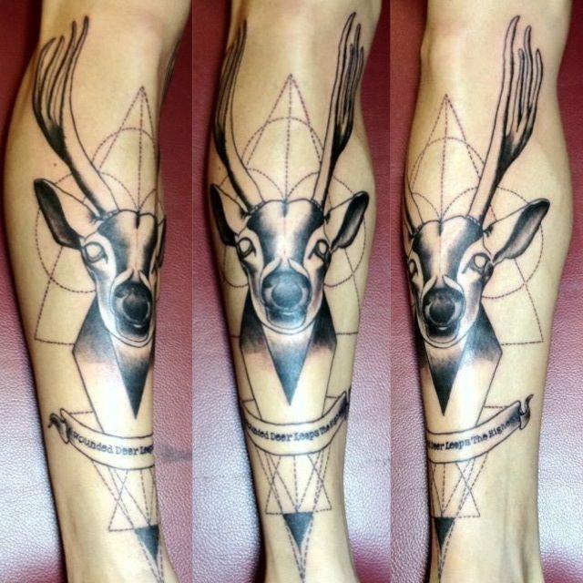 Geometric deer leg tattoo