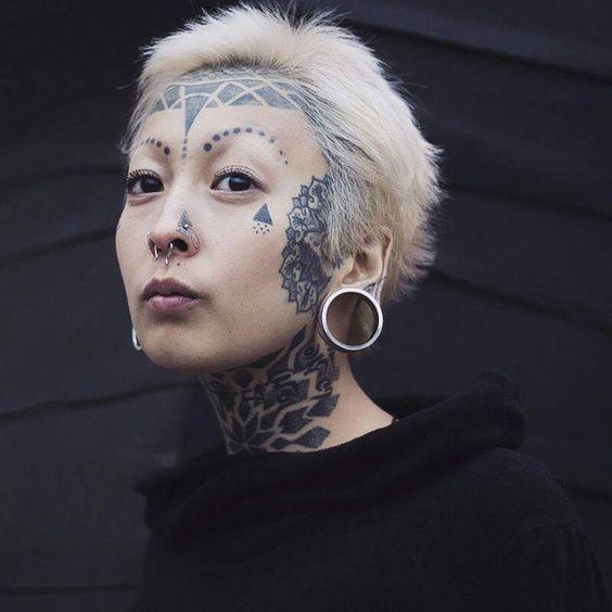 Geometric face tattoo 1