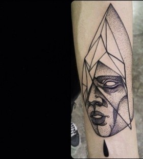 Geometric face tattoo by Michele Zingales
