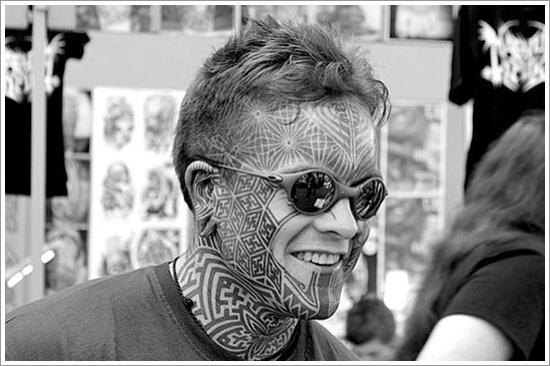 Geometric face tattoo