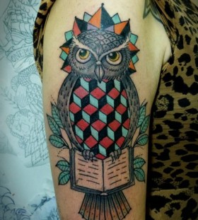 Geometric owl arm tattoo by Tyago Compiani