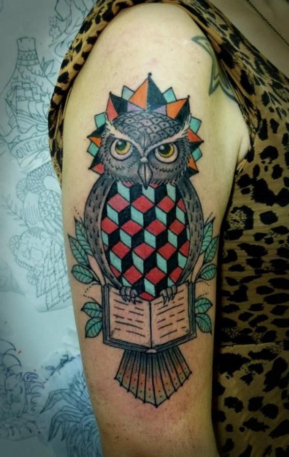Geometric owl arm tattoo by Tyago Compiani