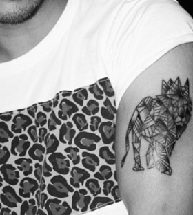 Geometrical lion arm tattoo