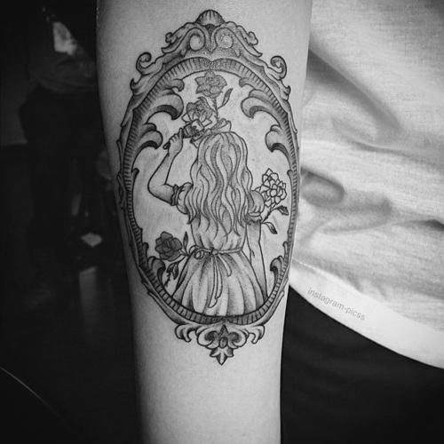 Girl brushing hair frame tattoo