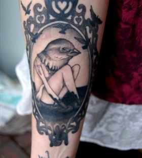 Girl with a birds head frame tattoo