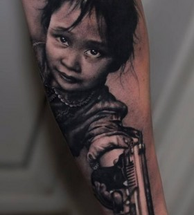 Girl with a gun tattoo by Riccardo Cassese