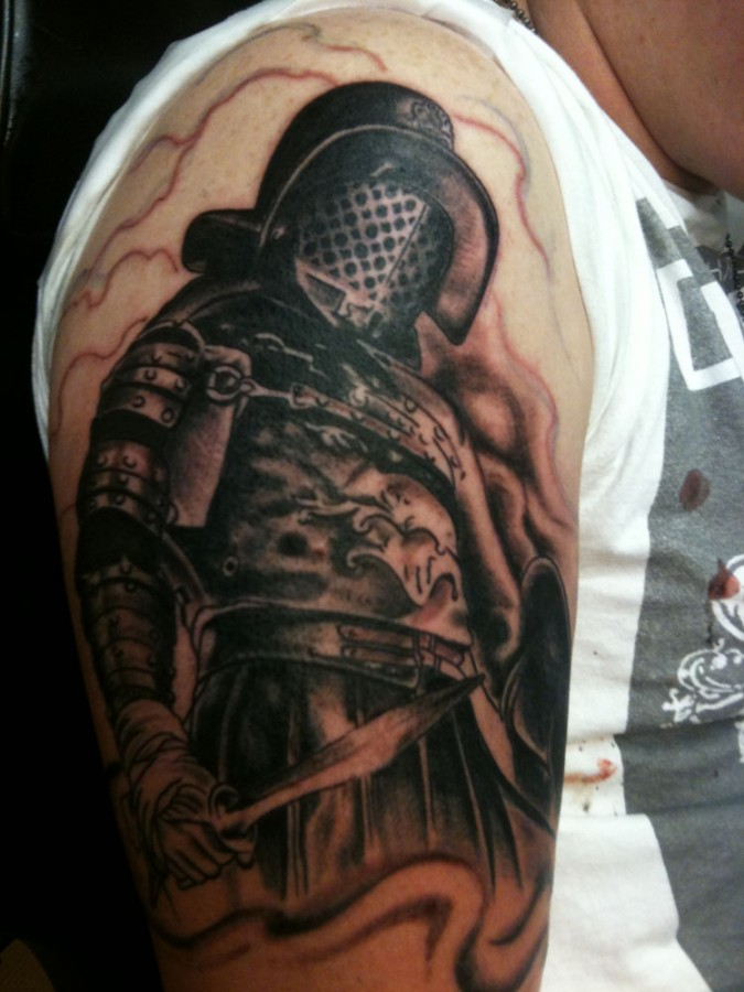 Gladiator with a sword tattoo