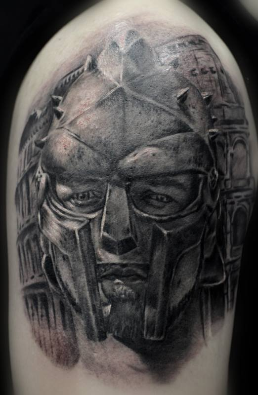 Gladiator's face arm tattoo