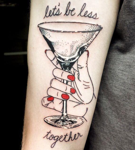 Glass and writing tattoo