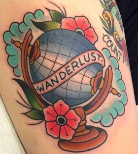 Globe and flowers tattoo by Clare Hampshire