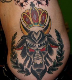 Goat and crown tattoo