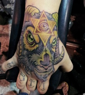 Goat and triangle eye tattoo