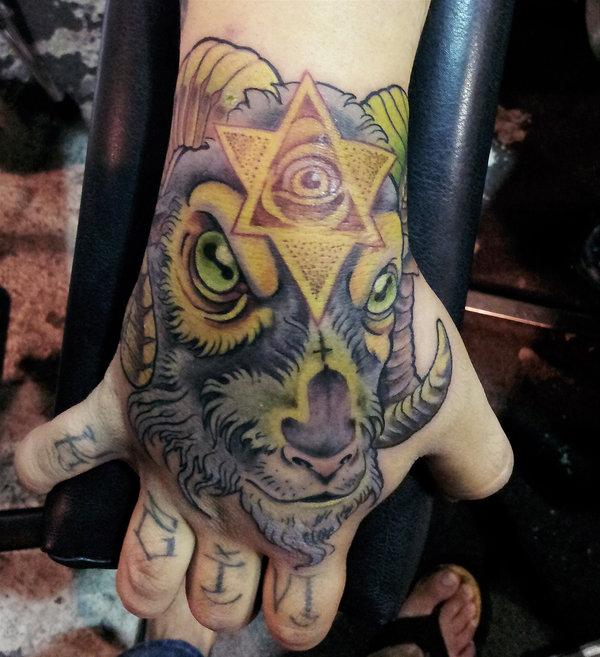 Goat and triangle eye tattoo