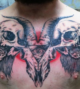 Goat skull and triangle eye tattoo