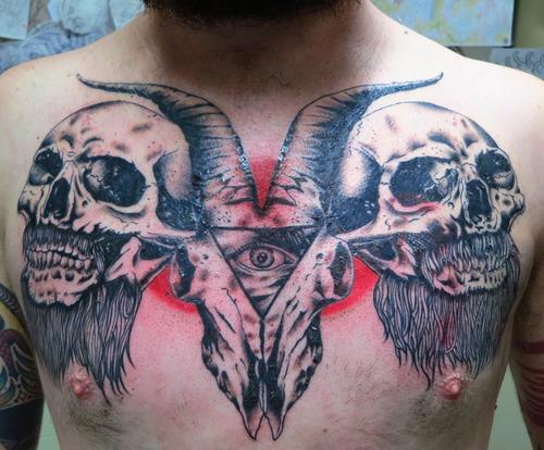 Goat skull and triangle eye tattoo