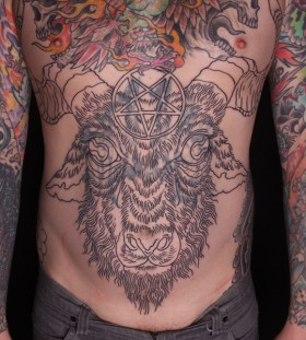 Goats' head stomach tattoo