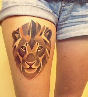 Golden geometric lion leg tattoo