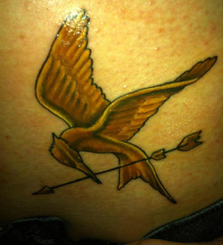 Golden mockingjay tattoo