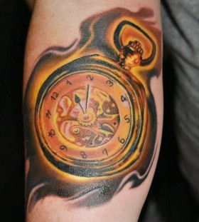 Golden pocket watch tattoo