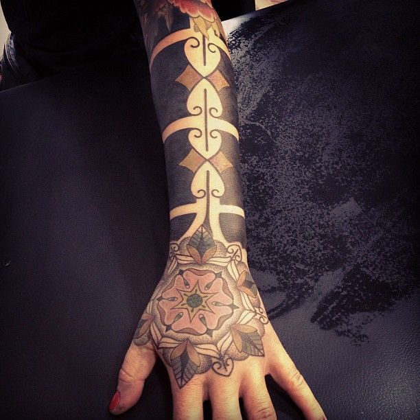Gorgeous arm tattoo by Gerhard Wiesbeck