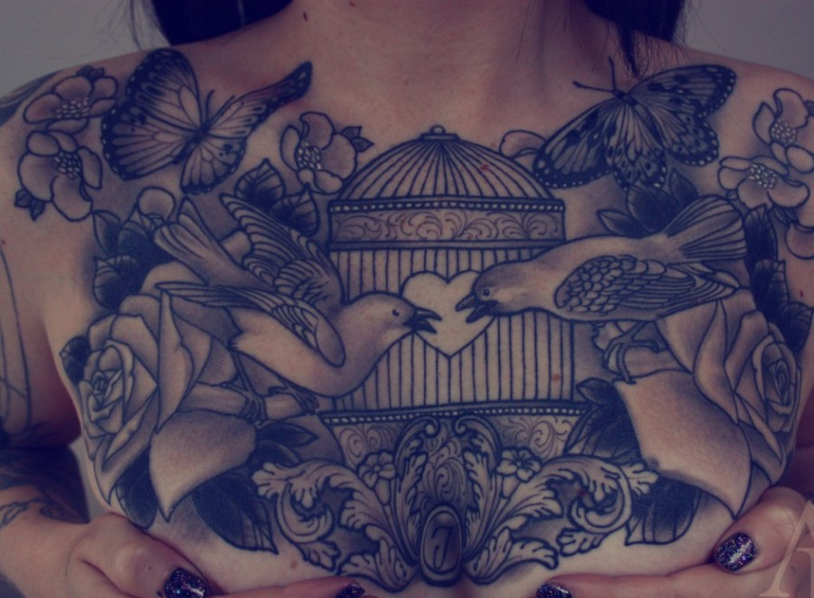 Gorgeous birdcage chest tattoo