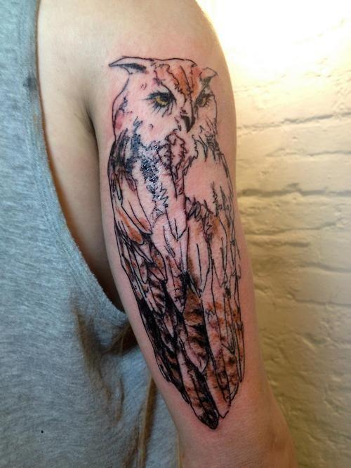 Gorgeous owl arm tattoo