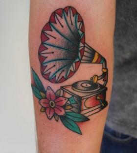Gramophone and flower tattoo