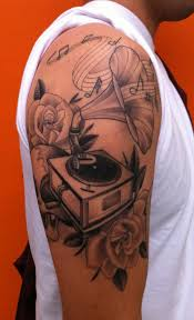 Gramophone and notes arm tattoo