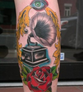 Gramophone and red rose tattoo