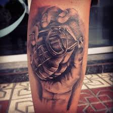 Great grenade in hand tattoo