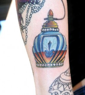 Great perfume bottle tattoo
