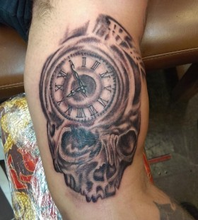 Great skull clock arm tattoo