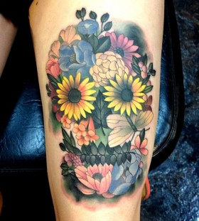 Great skull of flowers tattoo