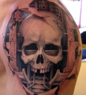 Great skull tattoo by Xavier Garcia Boix