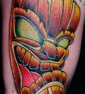 Green eyes tiki tattoo