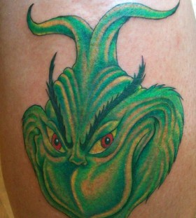 Green lovely looking grinch christmas tattoo