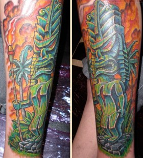 Green tiki tattoo