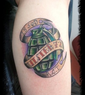 Grenade and writing tattoo