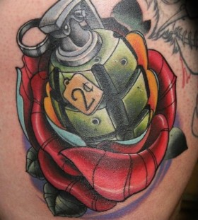 Grenade inside rose tattoo