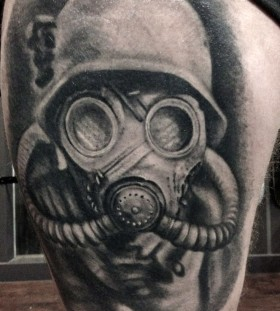 Grey ink gas mask tattoo