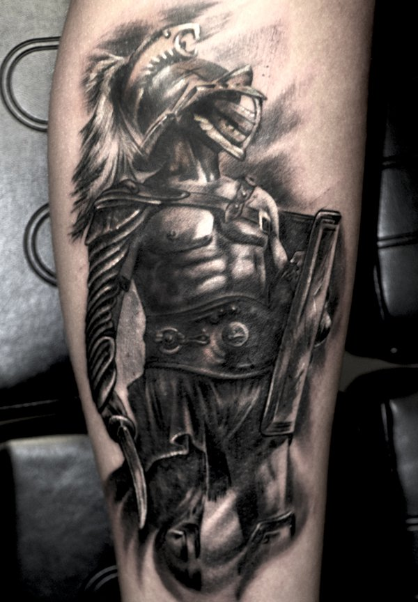 Grey ink gladiator tattoo