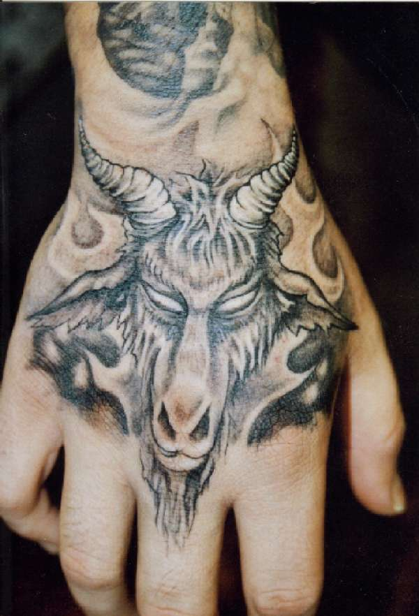 Grey ink goat hand tattoo