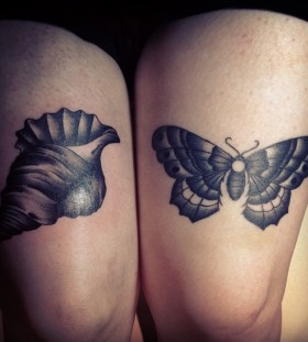 Grey ink shell tattoo