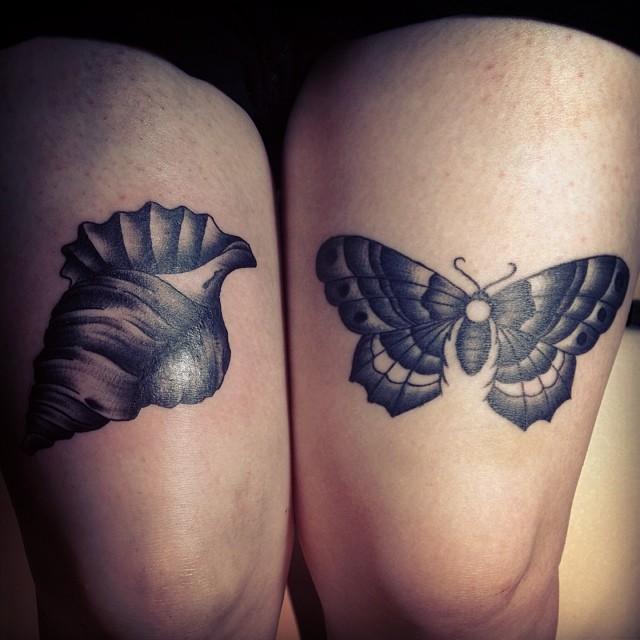 Grey ink shell tattoo