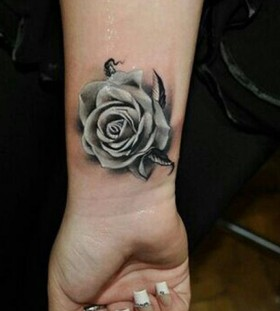 Grey rose wrist tattoo