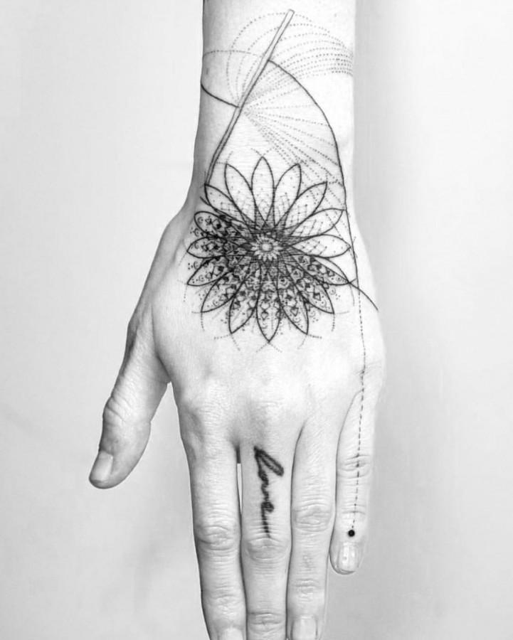 hand blackwork tattoo by mowgli_artist