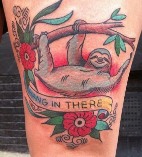 Hanging sloth and quote tattoo