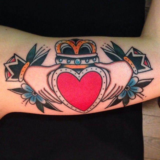 Heart and hands tattoo by Nick Oaks