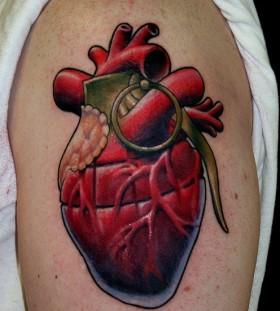 Heart grenade arm tattoo